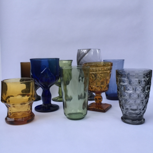 Mismatched collection of green glassware tumblers