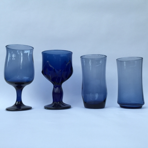 Mismatched collection of blue glassware tumblers